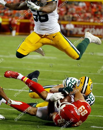 Jace Amaro, Greer Martini, Ahmad Thomas. Kansas City Chiefs tight end Jace Amaro (89) is tackled by Green Bay Packers linebacker Greer Martini (58) as linebacker Ahmad Thomas (56) leaps over them during the first half of an NFL preseason football game in Kansas City, Mo