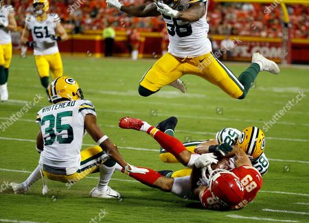 Kansas City Chiefs tight end Jace Amaro (89) is tackled by Green Bay Packers linebacker Greer Martini (58) as linebacker Ahmad Thomas (56) leaps over them, during the first half of an NFL preseason football game in Kansas City, Mo