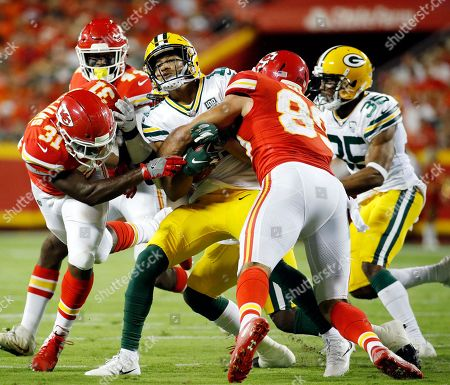 Jace Amaro, Trevor Davis, Darrel Williams. Green Bay Packers' Trevor Davis, center, is tackled by Kansas City Chiefs' Darrel Williams (31) and Jace Amaro on a kickoff return during the first half of an NFL preseason football game in Kansas City, Mo