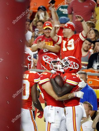 Stock Photo of Kansas City Chiefs running back Darrel Williams, right, celebrates his touchdown with tight end Jace Amaro (89) during the first half of an NFL preseason football game against the Green Bay Packers in Kansas City, Mo