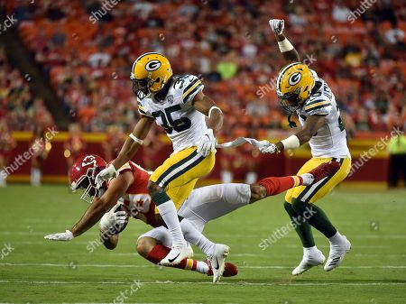 Kansas City Chiefs tight end Jace Amaro (89) is tackled by Green Bay Packers safety Jermaine Whitehead (35) and cornerback Jaire Alexander, right, during the first half of an NFL preseason football game