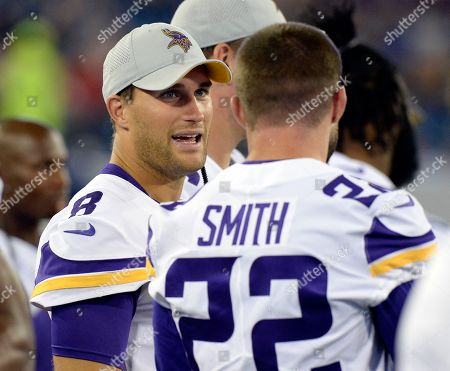 Kirk Cousins, Harrison Smith. Minnesota Vikings quarterback Kirk Cousins (8) talks with defensive back Harrison Smith (22) in the first half of a preseason NFL football game against the Tennessee Titans