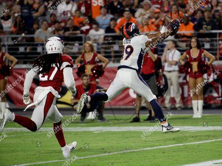 Stock Picture of Denver Broncos wide receiver Jordan Leslie scores past Arizona Cardinals defensive back Travell Dixon during the second half of a preseason NFL football game