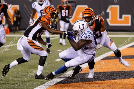 Indianapolis Colts tight end Erik Swoope (86) scores a touchdown against Cincinnati Bengals defensive back Trayvon Henderson (41) during the second half of an NFL preseason football game, in Cincinnati