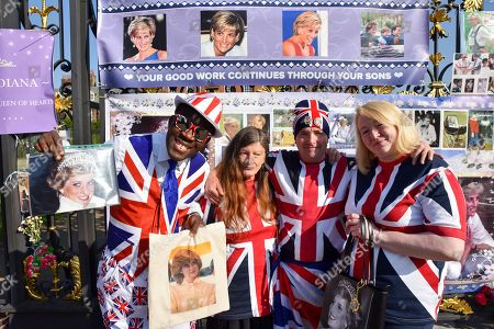 Supporters of Princess Diana commemorate the 21st anniversary of her death by placing pictures and flowers outside Kensington Palace. [L-R. Joseph Afrane, Caryll Foster, Maria Scott, John Loughrey]