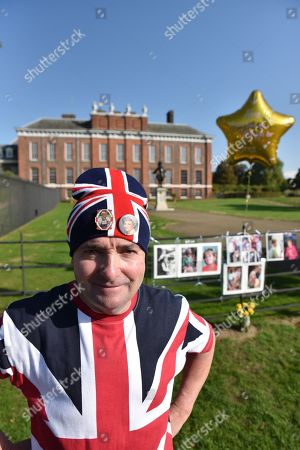 Supporters of Princess Diana commemorate the 21st anniversary of her death by placing pictures and flowers outside Kensington Palace.  [John Loughrey]