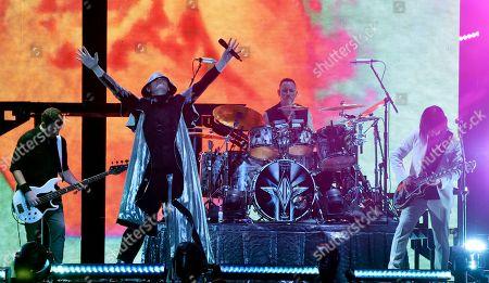 Billy Corgan, Jimmy Chamberlin, James Iha, Jack Bates. Jack Bates, from left, Billy Corgan, Jimmy Chamberlin and James Iha of Smashing Pumpkins perform at The Forum, in Inglewood, Calif