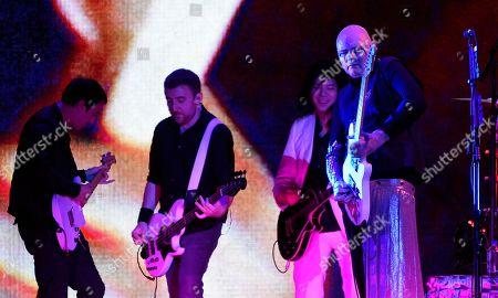 Jeff Schroeder, Jack Bates, James Iha, Billy Corgan. Jeff Schroeder, from left, Jack Bates, James Iha and Billy Corgan of Smashing Pumpkins perform at The Forum, in Inglewood, Calif