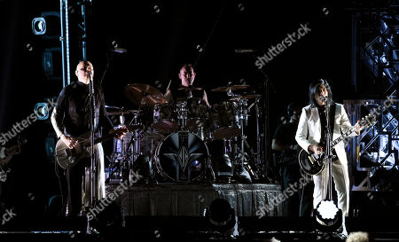 Billy Corgan, Jimmy Chamberlin, James Iha. Billy Corgan, from left, Jimmy Chamberlin and James Iha of Smashing Pumpkins perform at The Forum, in Inglewood, Calif