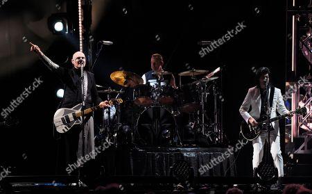 Billy Corgan, Jimmy Chamberlin, James Iha. Billy Corgan, left, Jimmy Chamberlin and James Iha of Smashing Pumpkins perform at The Forum, in Inglewood, Calif