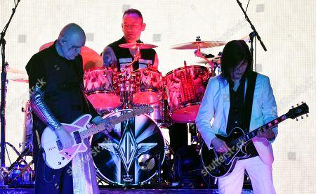 Billy Corgan, Jimmy Chamberlin, James Iha. Billy Corgan, left, Jimmy Chamberlin, center, and James Iha of Smashing Pumpkins perform at The Forum, in Inglewood, Calif