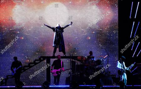 Billy Corgan, top, and from left, Jeff Schroeder, Jack Bates, Jimmy Chamberlin and James Iha of Smashing Pumpkins perform at The Forum, in Inglewood, Calif