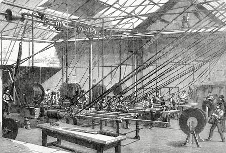 Machines Covering the Atlantic Cable Wire with Gutta Percha at the Gutta Percha Company's Works in Wharf Road London. Before the Advent of Man-made Materials Gutta Percha Resin From the Isonandra Gutta Tree Provided an Ideal Insulating Waterproof For the Cable. the Illustrated London News. March 14th 1857. P.243.