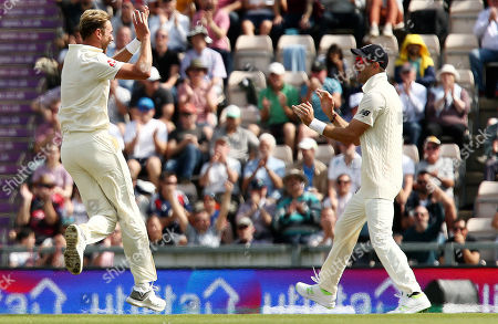 Stuart Broad of England celebrates taking the wicket of Shikhar Dhawan of India with a catch from Jos Buttler.