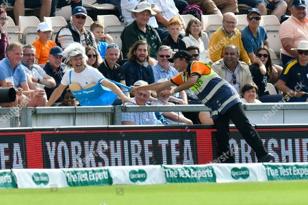A pitch invader in fancy dress gets the better of a steward at tea who is unable to hold on to him during day two of the fourth SpecSavers International Test Match 2018 match between England and India at the Ageas Bowl, Southampton