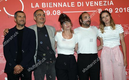 (L-R) French actor Guillaume Canet, French filmmaker Olivier Assayas, French actors Nora Hamzawi, Vincent Macaigne and Christa Theret pose during a photocall for 'Doubles Vies' during the 75th annual Venice International Film Festival, in Venice, Italy, 31 August 2018. The movie is presented in the official competition 'Venezia 75' at the festival running from 29 August to 08 September 2018.