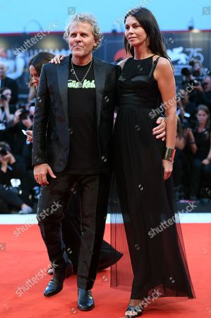 Italian fashion entrepreneur Renzo Rosso (L) and partner Arianna Alessi arrive for the premiere of 'A Star Is Born' during the 75th annual Venice International Film Festival, in Venice, Italy, 31 August 2018. The movie is presented Out Competition at the festival running from 29 August to 08 September 2018.