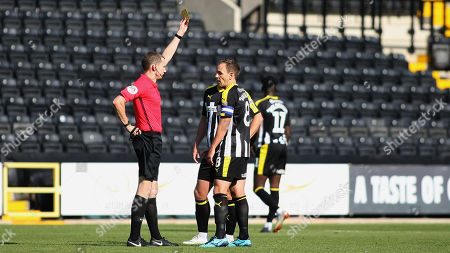 Notts skipper David Vaughan goes into the book for a late challenge