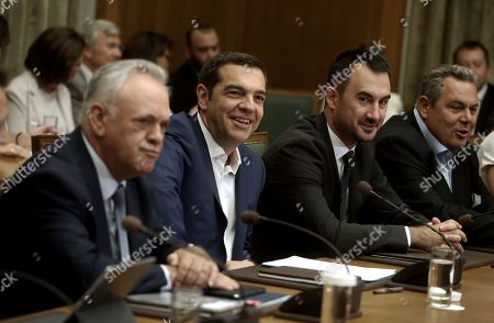 Stock Image of Greek Prime Minister Alexis Tsipras (2-L) chairs a cabinet meeting next to Vice-President and Minister of Economy Yannis Dragasakis (L), Interior Minister Alexandros Charitsis (2-R) and National Defense Minister Panos Kammenos (R) at the parliament in Athens, Greece, 31 August 2018. It was the first cabinet meeting after a government reshuffle. Tsipras will present the priorities in the post-memorandum era and the 2019 draft budget.