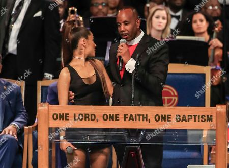 Bishop Charles Ellis (R) talks with US recording artist Ariana Grande (L) during the funeral service for US singer Aretha Franklin at the Greater Grace Temple in Detroit, Michigan, USA, 31 August 2018 (issued 01 September 2018). Aretha Franklin, known as the Queen of Soul for recording hits such as RESPECT, Chain of Fools and many others, died 16 August 2018 from pancreatic cancer and was buried in Woodlawn Cemetery on 31 August.