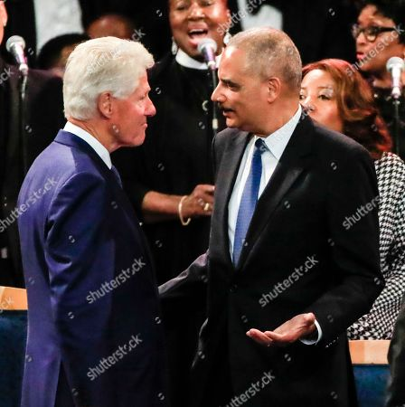 Former US President Bill Clinton (L) talks with former US Attorney General Eric Holder (R) before the start of funeral services for US Singer Aretha Franklin at the Greater Grace Temple in Detroit, Michigan, USA, 31 August 2018. Aretha Franklin, known as the Queen of Soul for recording hits such as RESPECT, Chain of Fools and many others, died 16 August 2018 from pancreatic cancer and will be buried in Woodlawn Cemetery on 31 August.