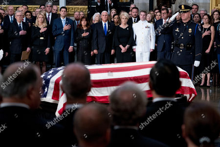 (L-R) US Senate Majority Leader Mitch McConnell of Ky., Janna Ryan, House Speaker Paul Ryan of Wis., Karen Pence, Vice President Mike Pence, McCain's wife Cindy McCain, and McCain's sons Navy Lt. Jack McCain and Doug McCain watch as the casket of US Senator John McCain, R-Ariz.,  lies in state in the Rotunda of the US Capitol, in Washington, DC, USA, 31 August 2018. McCain will lie in state at the US Capitol and have a funeral service at the National Cathedral before being laid to rest at the US Naval Academy in Annapolis, Maryland. McCain died 25 August, 2018 from brain cancer at his ranch in Sedona, Arizona, USA. He was a veteran of the Vietnam War, served two terms in the US House of Representatives, and was elected to five terms in the US Senate. McCain also ran for president twice, and was the Republican nominee in 2008.