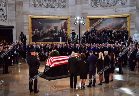 United States Senator Mitch McConnell, Speaker of the United States House of Representatives Paul Ryan and wife Janna Ryan, Vice President of the United States Mike Pence and wife Karen Pence stand over the casket of former Senator John McCain in the Capitol Rotunda as it lies in state at the U.S. Capitol, in Washington, DC, USA, 31 August 2018. McCain will lie in state at the US Capitol and have a funeral service at the National Cathedral before being laid to rest at the US Naval Academy in Annapolis, Maryland. McCain died 25 August, 2018 from brain cancer at his ranch in Sedona, Arizona, USA. He was a veteran of the Vietnam War, served two terms in the US House of Representatives, and was elected to five terms in the US Senate. McCain also ran for president twice, and was the Republican nominee in 2008.