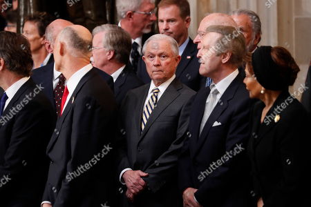 Stock Image of US Attorey General Jeff Sessions (C) and former Defense Secretary William Cohen (2-R) arrive prior to ceremonies honoring US Senator John McCain, R-Ariz., in the Rotunda of the US Capitol, in Washington, DC, USA, 31 August 2018. McCain will lie in state at the US Capitol and have a funeral service at the National Cathedral before being laid to rest at the US Naval Academy in Annapolis, Maryland. McCain died 25 August, 2018 from brain cancer at his ranch in Sedona, Arizona, USA. He was a veteran of the Vietnam War, served two terms in the US House of Representatives, and was elected to five terms in the US Senate. McCain also ran for president twice, and was the Republican nominee in 2008.