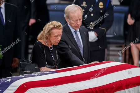 Former Independent Senator Joseph Lieberman (R) and his wife Hadassah Lieberman (L) take a moment at the casket Senator John McCain after a memorial service in the Rotunda, where he will lie in state for the rest of the day in Washington, DC, USA, 31 August 2018. McCain died 25 August, 2018 from brain cancer at his ranch in Sedona, Arizona, USA. He was a veteran of the Vietnam War, served two terms in the US House of Representatives, and was elected to five terms in the US Senate. McCain also ran for president twice, and was the Republican nominee in 2008.