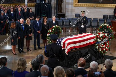 US Vice President Mike Pence (2-L), Karen Pence (L), Janna Ryan (3-L), Speaker of the House Paul Ryan (3-R), US Secretary of Transportation Elaine Chao (2-R) and Senate Majority Leader Mitch McConnell (R) take a moment at the casket of Senator John McCain after a memorial service in the Rotunda, where he will lie in state for the rest of the day in Washington, DC, USA, 31 August 2018. McCain died 25 August, 2018 from brain cancer at his ranch in Sedona, Arizona, USA. He was a veteran of the Vietnam War, served two terms in the US House of Representatives, and was elected to five terms in the US Senate. McCain also ran for president twice, and was the Republican nominee in 2008.