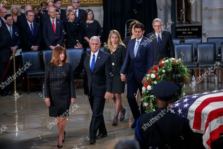 US Vice President Mike Pence (2-L), Karen Pence (L), Janna Ryan (3-L), Speaker of the House Paul Ryan (3-R), US Secretary of Transportation Elaine Chao (back 2-R) and Senate Majority Leader Mitch McConnell (R) take a moment at the casket of Senator John McCain after a memorial service in the Rotunda, where he will lie in state for the rest of the day in Washington, DC, USA, 31 August 2018. McCain died 25 August, 2018 from brain cancer at his ranch in Sedona, Arizona, USA. He was a veteran of the Vietnam War, served two terms in the US House of Representatives, and was elected to five terms in the US Senate. McCain also ran for president twice, and was the Republican nominee in 2008.
