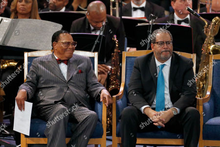 Louis Farrakhan, left, and Michael Eric Dyson listen during the funeral service for Aretha Franklin at Greater Grace Temple, in Detroit. Franklin died Aug. 16, 2018 of pancreatic cancer at the age of 76