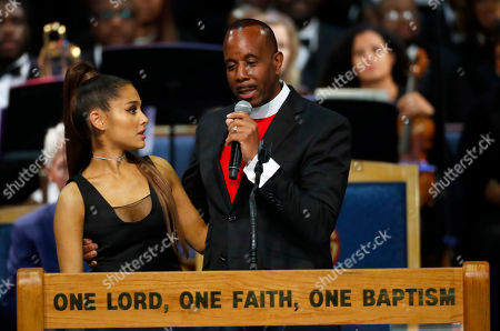 Bishop Charles H. Ellis, III, right, hugs Ariana Grande after she performed during the funeral service for Aretha Franklin at Greater Grace Temple, in Detroit. Franklin died Aug. 16, 2018 of pancreatic cancer at the age of 76