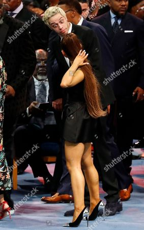 Ariana Grande, front, talks with Pete Davidson during the funeral service for Aretha Franklin at Greater Grace Temple, in Detroit. Franklin died Aug. 16, 2018 of pancreatic cancer at the age of 76