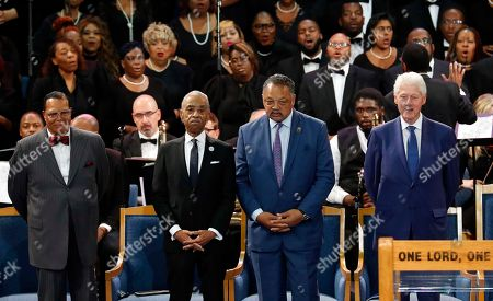 Louis Farrakhan, from left, Rev. Al Sharpton, Rev. Jesse Jackson and former President Bill Clinton attend the funeral service for Aretha Franklin at Greater Grace Temple, in Detroit. Franklin died Aug. 16, 2018 of pancreatic cancer at the age of 76