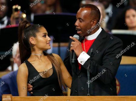 Stock Picture of Bishop Charles H. Ellis, III, right, speaks with Ariana Grande after she performed during the funeral service for Aretha Franklin at Greater Grace Temple, in Detroit. Franklin died Aug. 16, 2018 of pancreatic cancer at the age of 76