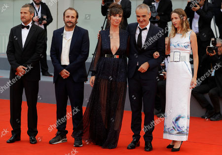 Actor Guillaume Canet, left, actor Vincent Macaigne, second left, actor Nora Hamzawi, centre, director Olivier Assayas, second right, and actor Christa Theret, right, pose for photographers upon arrival at the premiere of the film 'Double Vies' at the 75th edition of the Venice Film Festival in Venice, Italy, Friday, Aug. 31, 2018