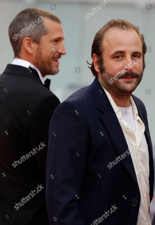 Actors Guillaume Canet, left, and Vincent Macaigne, right, pose for photographers upon arrival at the premiere of the film 'Double Vies' at the 75th edition of the Venice Film Festival in Venice, Italy, Friday, Aug. 31, 2018