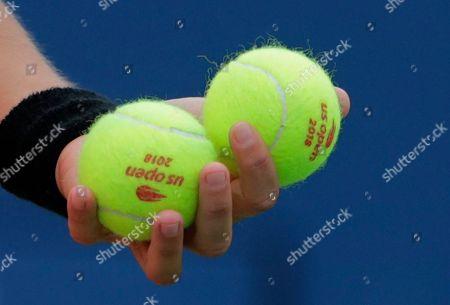 Anastasija Sevastova, of Latvia, holds tennis ball before serving to Ekaterina Makarova, of Russia, during the third round of the U.S. Open tennis tournament, in New York