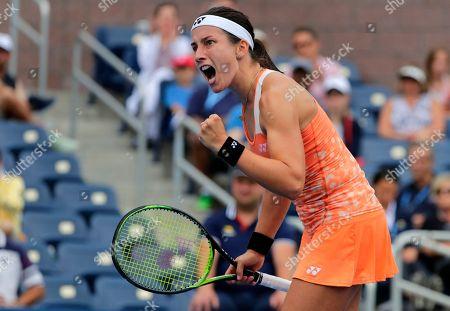Anastasija Sevastova, of Latvia, reacts after defeating Ekaterina Makarova, of Russia, during the third round of the U.S. Open tennis tournament, in New York