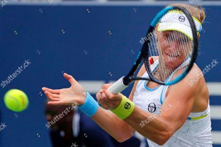 Ekaterina Makarova, of Russia, returns a shot to Anastasija Sevastova, of Latvia, during the third round of the U.S. Open tennis tournament, in New York