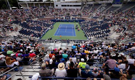 Fans watch as Ekaterina Makarova, of Russia, returns a shot to Anastasija Sevastova, of Latvia, during the third round of the U.S. Open tennis tournament, in New York
