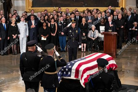 Mike Pence, Cindy McCain, Jack McCain, Douglas McCain, Bridget McCain, Sidney McCain, Jimmy McCain, Andrew McCain, Meghan McCain, Roberta McCain. The flag-draped casket bearing the remains of Sen. John McCain of Arizona, who lived and worked in Congress over four decades, is carried into the U.S. Capitol rotunda for a farewell ceremony and public visitation, in Washington. From left in front row are Vice President Mike Pence, wife Cindy McCain, son Jack McCain, son Douglas McCain, daughter Bridget McCain, daughter Sidney McCain, son Jimmy McCain, son Andrew McCain, daughter Meghan McCain, and Roberta McCain, John McCain's mother. McCain was a six-term senator, a former Republican nominee for president, and a Navy pilot who served in Vietnam, where he endured five-and-a-half years as a prisoner of war. He died Aug. 25 from brain cancer at age 81