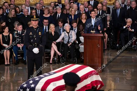 Sidney McCain, Jimmy McCain, Meghan McCain, Roberta McCain, Paul Ryan. Speaker of the House Paul Ryan, R-Wis., right, eulogizes Sen. John McCain of Arizona, who lived and worked in Congress over four decades, during a ceremony in the U.S. Capitol rotunda, in Washington. Family members in front row, from left, are daughter Sidney McCain, son Jimmy McCain, daughter Meghan McCain, and his 106-year-old mother Roberta McCain
