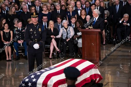 Sidney McCain, Jimmy McCain, Meghan McCain, Roberta McCain, Mike Pence. Vice President Mike Pence, right, eulogizes Sen. John McCain of Arizona, who lived and worked in Congress over four decades, during a ceremony in the U.S. Capitol rotunda, in Washington. Family members in front row, from left, are daughter Sidney McCain, son Jimmy McCain, daughter Meghan McCain, and his 106-year-old mother Roberta McCain