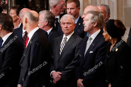 U.S. Attorey General Jeff Sessions (C) and former Defense Secretary William Cohen (2ndR) arrive prior to ceremonies honoring late Senator John McCain inside the U.S. Capitol Rotunda in Washington
