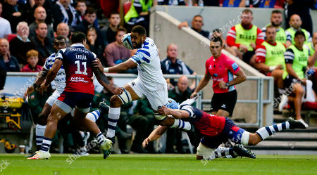 Stock Picture of Taulupe (Toby) Faletau of Bath makes a rampaging run down the wing