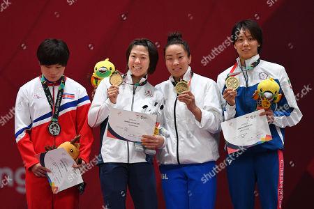 (L-R) Kim Jin A (PRK), Monique Gonzalez Tamaoki (JPN), Dorjsuren Sumiya (MGL), Lien Chen ling (TPE), Yasuhiro Yamashita (JPN) - Judo : Women's -57kg Victory ceremony at Jakarta Convention Center Plenary Hall