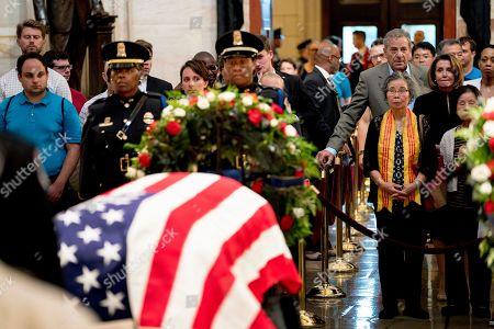 Nancy Pelosi, Paul Pelosi. House Minority Leader Nancy Pelosi of Calif., at right, and her husband Paul Pelosi, pay their respects to Sen. John McCain, R-Ariz., as he lies in state in the Rotunda of the U.S. Capitol, in Washington