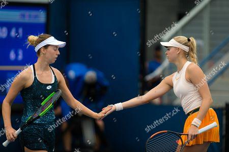 Fanny Stollar of Hungary and Nina Stojanovic playing doubles